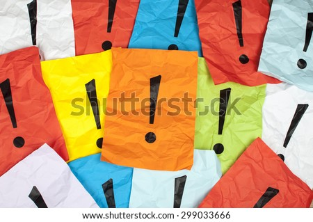 exclamation mark on sheet of  paper - stock photo