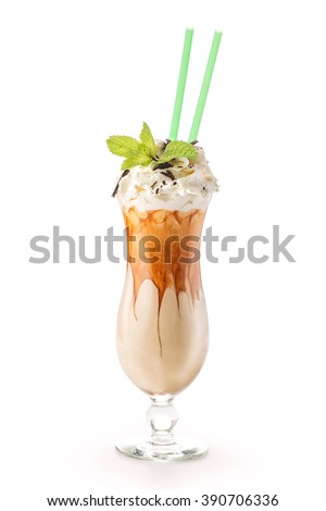 Exclusive coffee cocktail with caramel topping on glass with cream and mint leaf, isolated on white background, frappe - stock photo