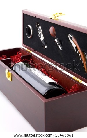 Exclusive red wine with bottle openers in a gift box as a closeup image isolated on white background - stock photo