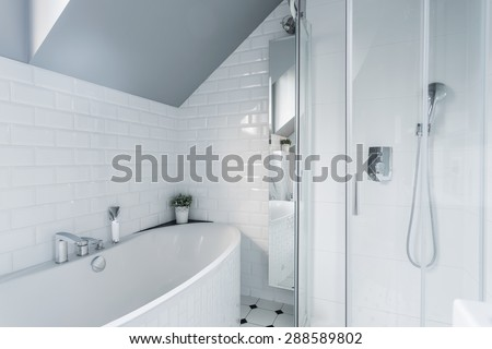 Exclusive white bathroom with bath and shower - stock photo