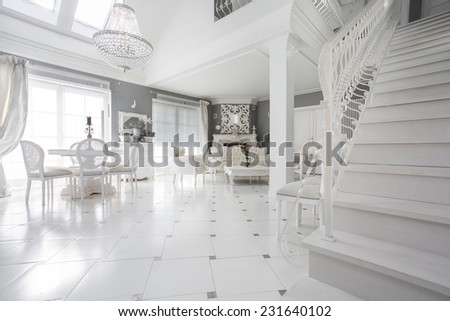 Exclusive white living room with marble floor - stock photo