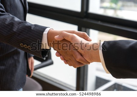 executive businessman hand shake with another business man show their corporation