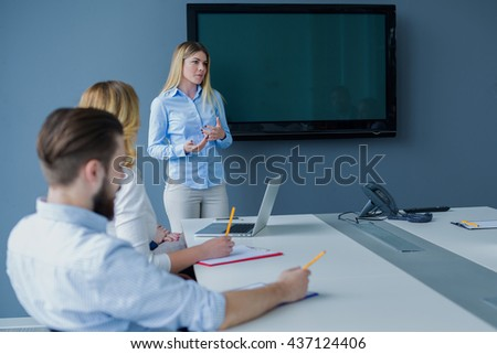 Executive businesswoman presenting her idea at business meeting. Teamwork. - stock photo