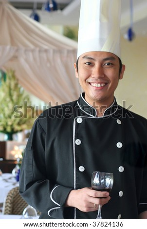 executive chef salute at restaurant - stock photo