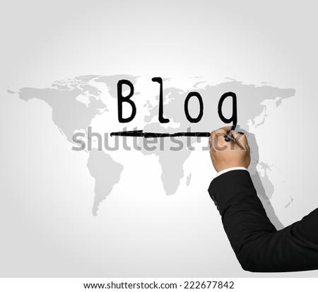 Executive Hand writing Blog - stock photo