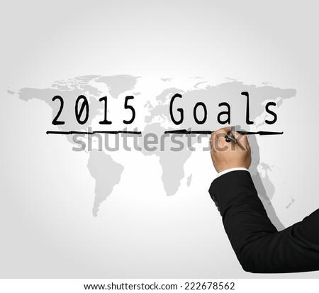 Executive Hand writing 2015 Goals - stock photo