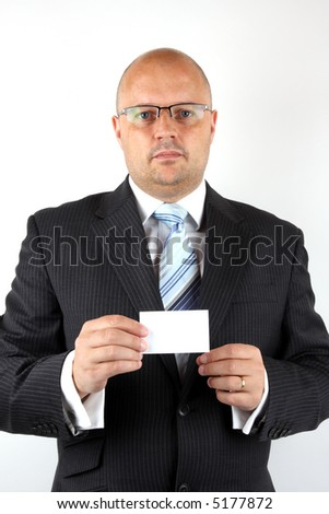 Executive holding a business card
