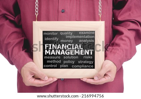 "Executive holding a hanging frame with ""FINANCIAL MANAGEMENT"" text - stock photo"
