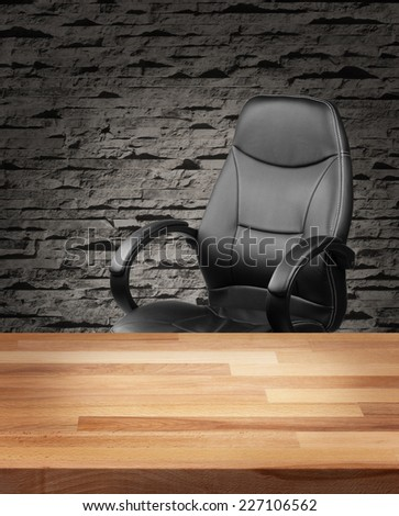 Executive leather chair and wooden table in luxury office interior - stock photo