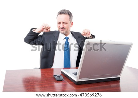 Executive manager taking a break and stretching in his office isolated on white background