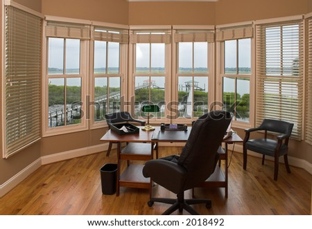 Executive office with view of the water - stock photo