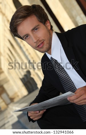 Executive reading newspaper - stock photo