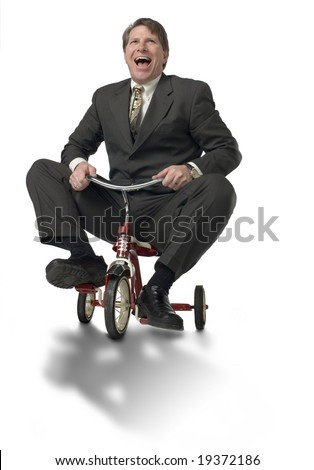 Executive riding child's tricycle - stock photo