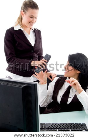 executive taking phone receiver from her secretary in office - stock photo