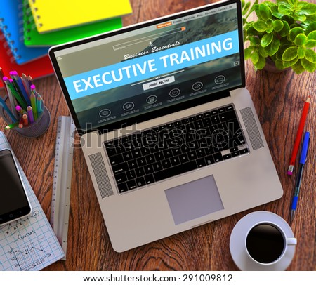 Executive Training Concept. Modern Laptop and Different Office Supply on Wooden Desktop background. - stock photo
