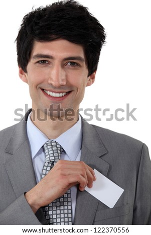 Executive with a blank businesscard - stock photo
