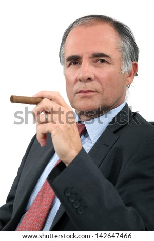 Executive with a cigar - stock photo