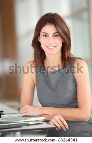 Executive woman working on laptop computer - stock photo