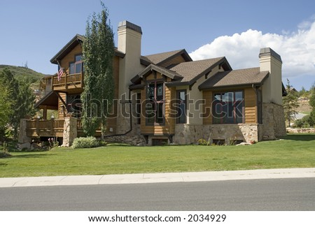 executive wooden home with flag and landscape on a hill - stock photo