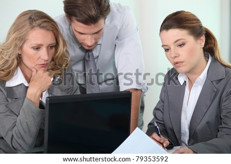 Executives with laptop computer - stock photo