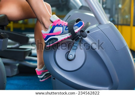 Exercise bike with spinning wheels. - stock photo