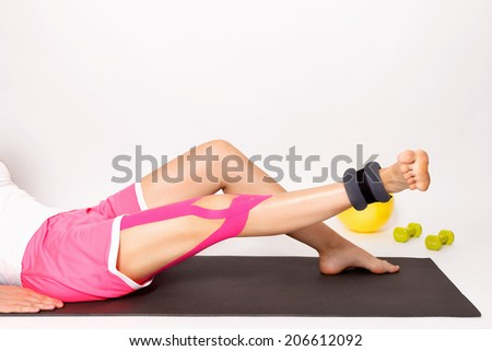 Exercise with ankle weight for strengthening injured leg - stock photo