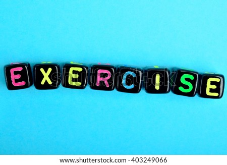 Exercise word on blue background - stock photo
