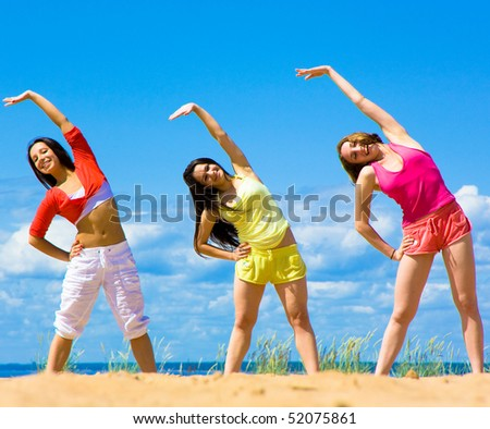 Exercising girls - stock photo