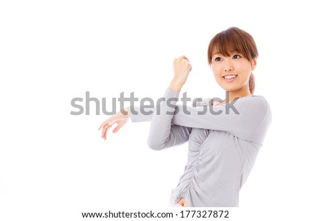 exercising young asian woman on white background