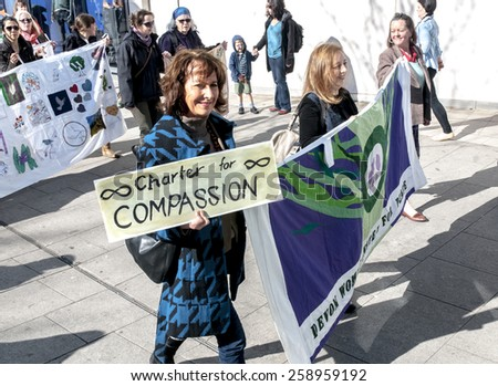 EXETER, ENGLAND - MARCH 7, 2015: Devon United Women walk through Exeter during the Walk for Peace through the city of Exeter to celebrate International Women's Day. - stock photo