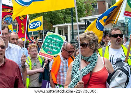 EXETER - JULY 10: PCS members walk into Princesshay Square during the public sector workers national day of action in Exeter City Centre on July 10,  2014 in Exeter, Devon, UK - stock photo