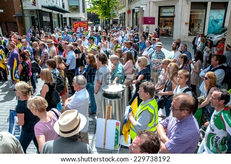 EXETER - JULY 10: The crowd in Princesshay Square during the public sector workers national day of action in Exeter City Centre on July 10,  2014 in Exeter, Devon, UK - stock photo