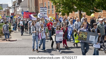 EXETER - JUNE 30: Hundreds walk the streets at the strikers march through Exeter City Centre  during the June 30 national strike and rally in Exeter City centre on June 30, 2011 in Exeter.