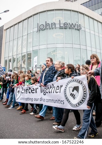 EXETER - NOVEMBER 16: Exeter Together march passed the John Lewis department store during the Exeter Together march and diversity festival on November 16, 2013 in Exeter, Devon, UK - stock photo