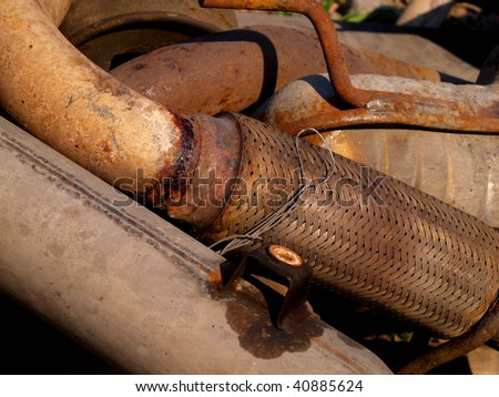 exhaust muffler old and rusty. Close up - stock photo