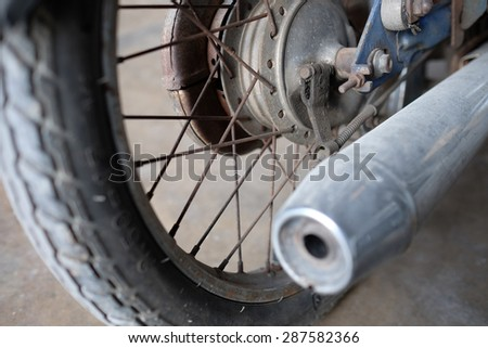 Exhaust of motorcycle and the wheel , from back angle. - stock photo