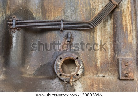 Exhaust pipe exit at the back of an old diesel engine under sunlight - stock photo