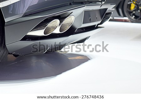 Exhaust pipe of a Black car - stock photo