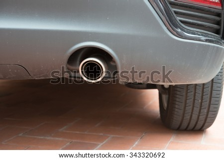 exhaust pipe of a silver car - stock photo
