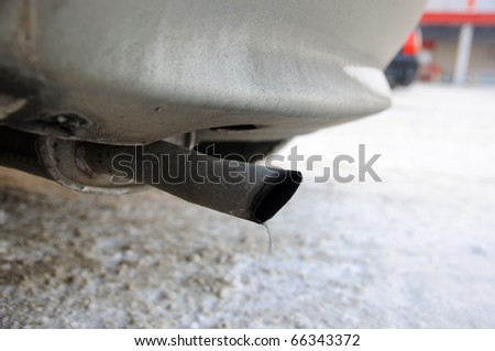 Exhaust pipe - pollution, smoke - stock photo