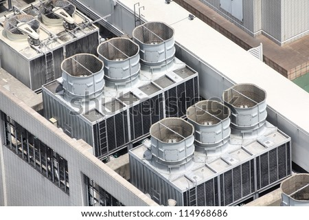 Exhaust vents of industrial air conditioning and ventilation units. Skyscraper roof top in Kobe, Japan. - stock photo