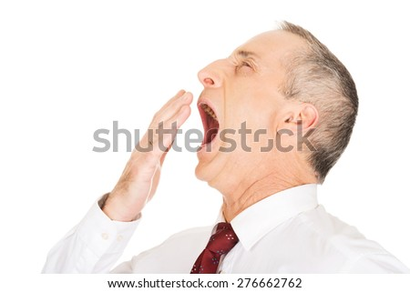 Exhausted and sleepy businessman yawning. - stock photo