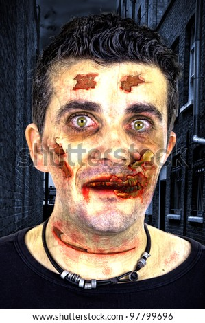 Exhausted bloody zombie - stock photo