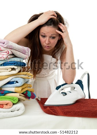 exhausted bride ironing towels. isolated picture on the white background - stock photo