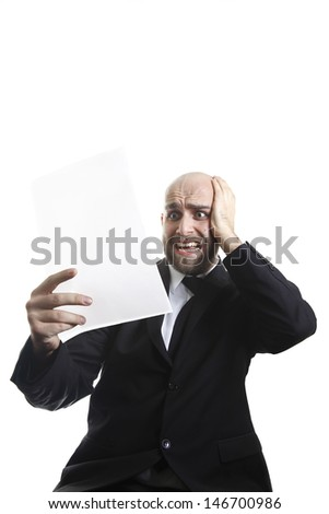 Exhausted businessman worried about the facts written on the paper!/It can�´t be true! - stock photo
