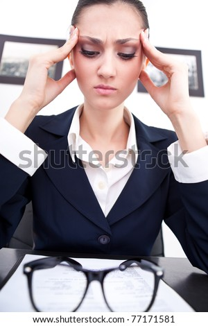 exhausted businesswoman has headache, face and emotional expression - stock photo
