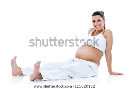 exhausted pregnant woman relaxing on floor after exercise - stock photo