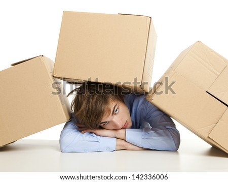 Exhausted young man with card boxes over him