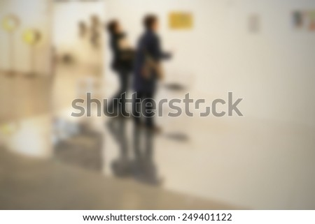 Exhibition art gallery background, location, works and people not recognizable. Intentionally blurred post production background. - stock photo