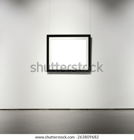 Exhibition hall with frame on the wall - stock photo